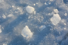 Fragmented and cracked ice. At sunset as a background Stock Photography