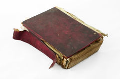 Fragmented old worn book. With red cover. White isolated Royalty Free Stock Photography