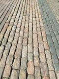 Fragmentet av m?ng--f?rgat stenar trottoar arkivbild