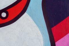 Fragmento bonito da parede com detalhe de grafittis, arte da rua Cores criativas abstratas da forma do desenho na cidade Foto de Stock