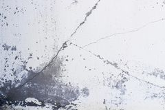 Fragmento da parede com riscos e quebras imagens de stock