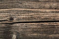Fragmento da parede da casa de madeira velha imagem de stock