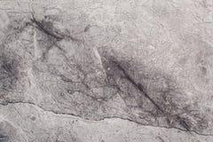 Fragmento da textura de pedra com riscos e quebras imagem de stock