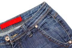 Fragmento das calças de brim Foto de Stock