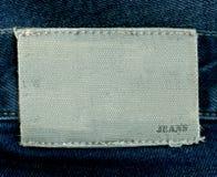 Fragmento das calças de brim com etiqueta pura para seu texto. Fotografia de Stock