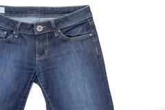 Fragmento das calças de brim no branco Imagens de Stock Royalty Free