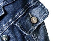 Fragmento de la chaqueta de los pantalones vaqueros Foto de archivo libre de regalías