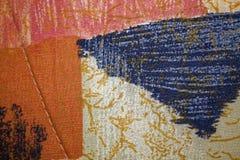 Fragmento de la materia textil colorida retra de la tapicería con el ornamento del vintage útil como fondo Fotografía de archivo libre de regalías