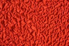 Fragmento de la materia textil retra colorida de la tapicería con el st hecho a mano del rojo Imagen de archivo