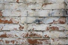 Fragmento de la pared de ladrillo vieja blanqueada, fondo Foto de archivo libre de regalías