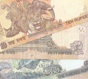 Fragmento de los billetes de banco indios - 10, 50 y 100 Indi Imágenes de archivo libres de regalías