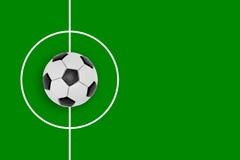 Fragmento de um campo e de uma bola de futebol Foto de Stock Royalty Free