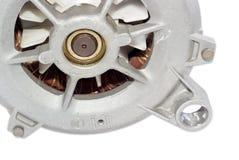 Fragmento de un primer del motor eléctrico en un fondo ligero Fotos de archivo libres de regalías