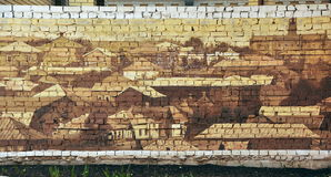 Fragmento de una pared de ladrillo con la imagen Fotografía de archivo