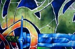 Fragmento de una pared vieja con la pintura colorida de la pintada imagen de archivo libre de regalías