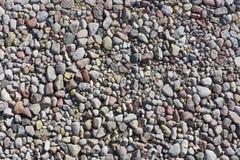 Fragmento de una playa ideal de la piedra del mar Fotos de archivo libres de regalías