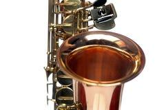 Fragmento del saxofón en el fondo blanco Fotos de archivo libres de regalías