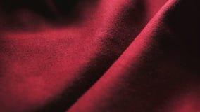 Fragmento do tecido vermelho Pode ser usado como um fundo filme