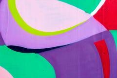 Fragmento hermoso de la pared con el detalle de la pintada, arte de la calle Colores creativos abstractos de la moda del dibujo e Fotografía de archivo libre de regalías