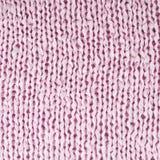 Fragmento rosado hecho punto del paño Fotos de archivo