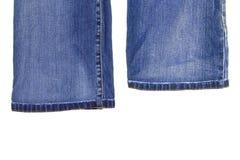 Fragmentos da calças da sarja de Nimes Fotografia de Stock