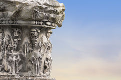 Fragments of ancient columns on sky background Stock Photography