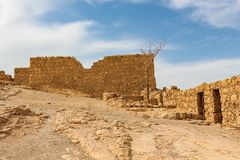 Fragments of the ancient wall of the fortress of Masada in Israel stock images