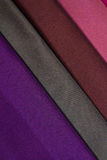 Fragments of colored fabrics. Several types of fabrics for manufacture of clothing Royalty Free Stock Image