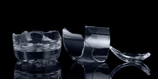 Fragments of glass container isolated on black background. royalty free stock images