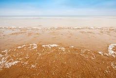 Fragments of ice on empty coast of Baltic Sea Royalty Free Stock Photo