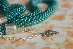 Fragments of a knitted necklace from beads of color aquamarine Royalty Free Stock Photo