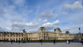 Fragments of Louvre buildings and Glass pyramid in Louvre Museum Royalty Free Stock Images