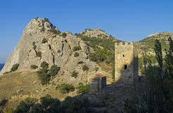 Fragments of medieval Genoese fortress - a tower and a Christian Royalty Free Stock Images