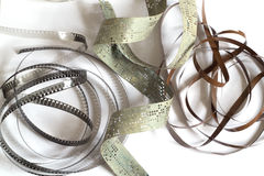 Fragments of the old film, magnetic tape and punched tape Royalty Free Stock Photo
