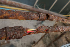 Fragments of old  pipes ,metal pipe destroyed. Rusty steel tube Royalty Free Stock Photo