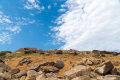 Fragments of old rocks and blue sky. Landscape stock image