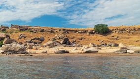 Fragments of old rocks and blue sky. Scenery stock image