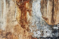 Fragments, parts of an old concrete wall, peeling paint of a cement surface. Grunge texture. Rusty, spotted concrete background