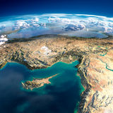 Fragments of the planet Earth. Cyprus, Syria and Turkey. Highly detailed fragments of the planet Earth with exaggerated relief, translucent ocean, illuminated by Royalty Free Stock Photo