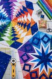 Fragments of quilt, accessories for patchwork, top view stock images