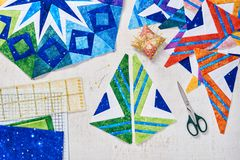 Fragments of quilt, accessories for patchwork, top view royalty free stock images