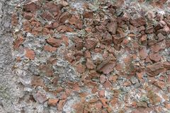 Fragments of red bricks in concrete. Red brick fragments in concrete as background stock image