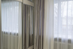 Fragments of silk curtains on  window Royalty Free Stock Image