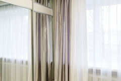 Fragments of silk curtains on  window Stock Images