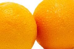 Fragments of two oranges isolated closeup Stock Photography