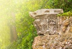 Fragmet antique column in sunlight Royalty Free Stock Photos