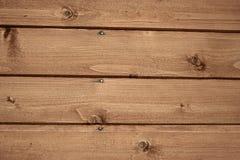 Fragnent de la pared de madera con los clavos Foto de archivo libre de regalías