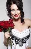 Fragrance. Beautiful Young Woman Holding Bouquet of Red roses. Valentine's Day Stock Image
