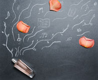 Fragrance bottle with drowing smell androse petal on the blackboard Royalty Free Stock Photo