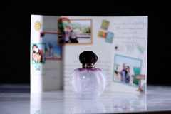 Fragrance bottle. Travel postcard on the background Royalty Free Stock Photo